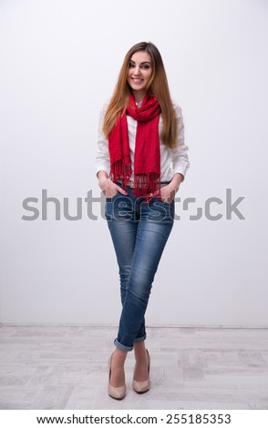 Full length portrait of a young happy student with hands in pocket - stock photo