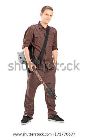 Full length portrait of a young male guitar player isolated on white background - stock photo
