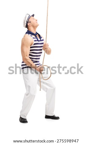 Full length portrait of a young male sailor pulling a rope and looking up isolated on white background - stock photo