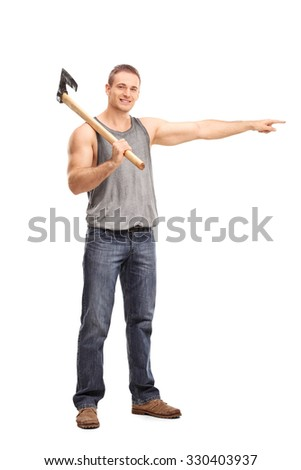 Full length portrait of a young man carrying an axe and pointing with his hand towards right isolated on white background - stock photo