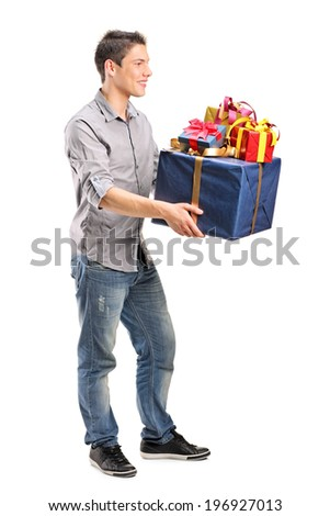 Full length portrait of a young man holding a bunch of presents isolated on white background - stock photo
