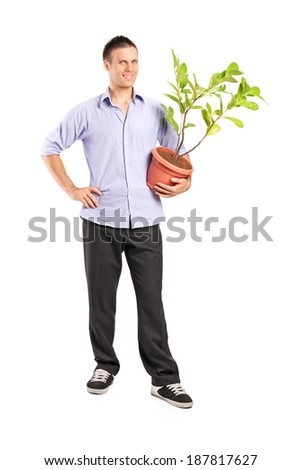 Full length portrait of a young man holding a plant isolated on white background - stock photo