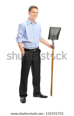 Full length portrait of a young man holding a shovel isolated against white background - stock photo