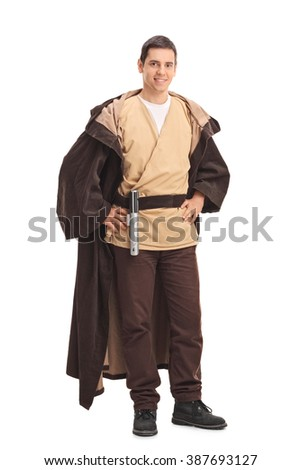 Full length portrait of a young man in a warrior costume looking at the camera isolated on white background - stock photo