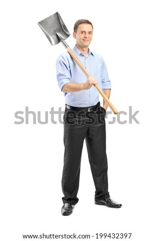 Full length portrait of a young man posing with a shovel over his shoulder isolated on white background - stock photo