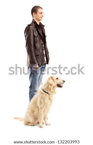 Full length portrait of a young man standing with a retriever dog isolated on white background - stock photo