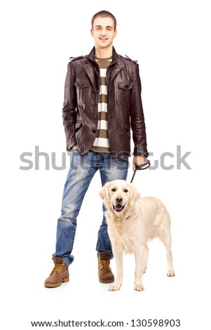 Full length portrait of a young man standing with a white retriever dog isolated on white background - stock photo