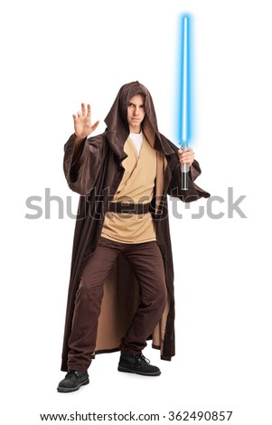 Full length portrait of a young man with a brown hooded cape and a laser sword isolated on white background - stock photo