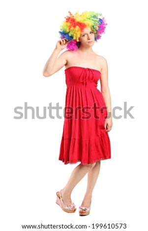 Full length portrait of a young sad woman with a wig isolated on white background - stock photo