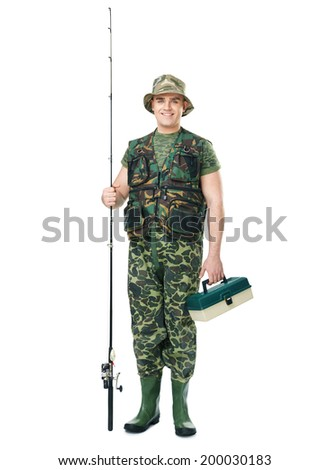Full length portrait of a young smiling fisherman in camouflage holding a fishing equipment isolated on white background - stock photo