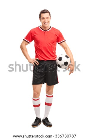 Full length portrait of a young soccer player holding a ball and posing isolated on white background - stock photo