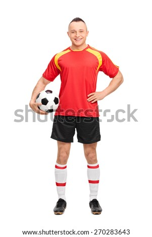 Full length portrait of a young soccer player holding a ball, smiling and posing isolated on white background - stock photo