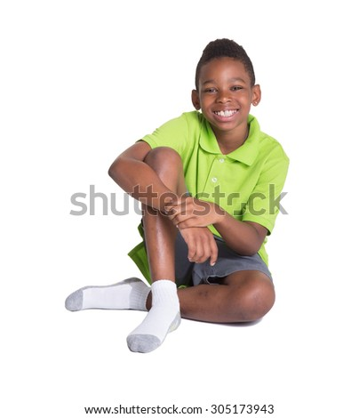 Full length portrait of a young tween sitting on the floor - stock photo