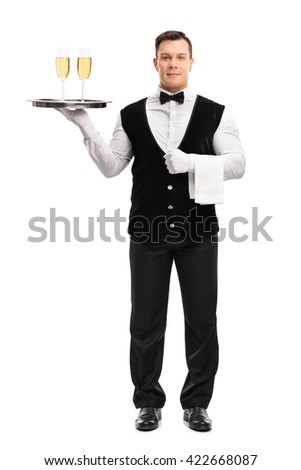 Full length portrait of a young waiter holding a tray with two glasses of white wine isolated on white background - stock photo