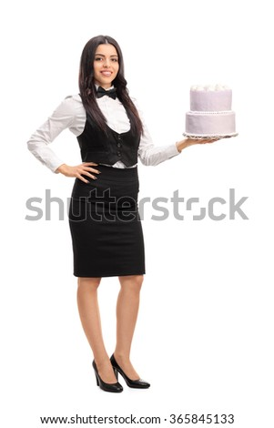 Full length portrait of a young waitress holding a cake and looking at the camera isolated on white background - stock photo