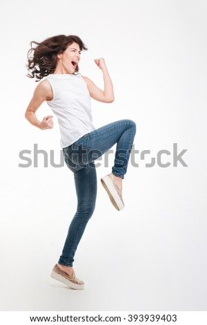Full length portrait of a young woman celebrating her success isolated on a white background - stock photo