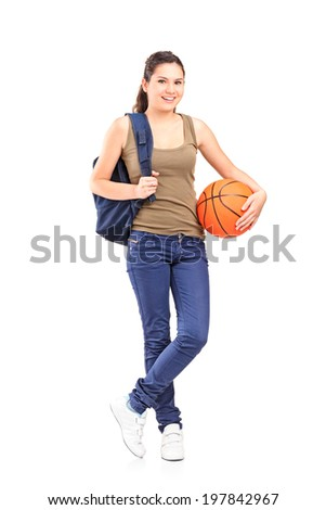 Full length portrait of a young woman holding a basketball isolated on white background - stock photo