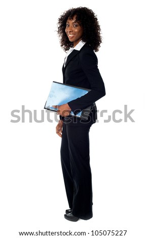 Full length portrait of african corporate lady holding folder and clipboard - stock photo
