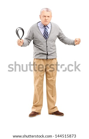 Full length portrait of an angry mature man holding a belt and looking at camera isolated on white background - stock photo