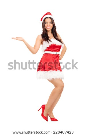 Full length portrait of an attractive girl in Santa costume isolated on white background - stock photo