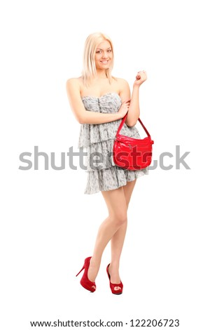 Full length portrait of an attractive sexy blond female holding a purse bag isolated on white background - stock photo