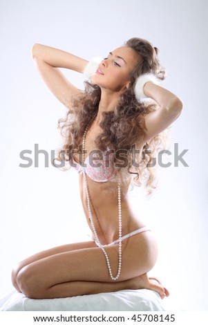 Full length portrait of an attractive woman in underwear - stock photo