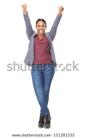 Full length portrait of an attractive young woman with hands raised in celebration - stock photo