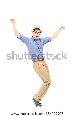 Full length portrait of an excited man dancing isolated on white background - stock photo