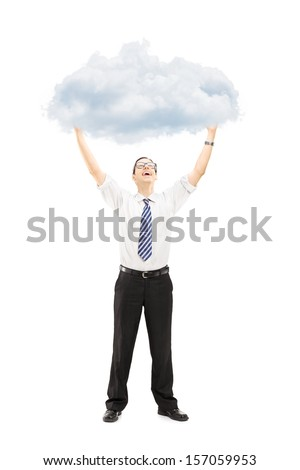 Full length portrait of an excited young man holding a cloud isolated on white background - stock photo