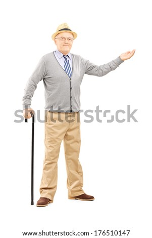 Full length portrait of an old man with cane gesturing with hand isolated on white background - stock photo