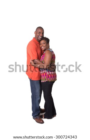 Full length portrait of an older couple standing close and looking at each other isolated - stock photo