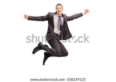 Full length portrait of an overjoyed businessman jumping and gesturing happiness shot in mid-air isolated on white background - stock photo