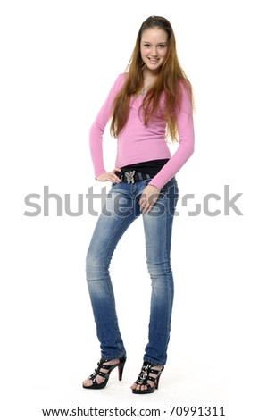 Full length portrait of an young smiling woman - stock photo