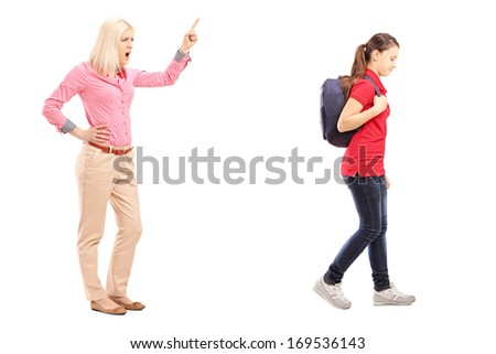 Full length portrait of angry mother yelling at her daughter, isolated on white background - stock photo