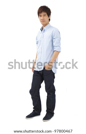 Full length portrait of Asian young man - stock photo