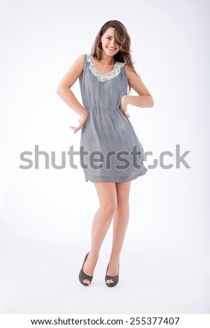 Full-length portrait of attractive cheerful woman - stock photo