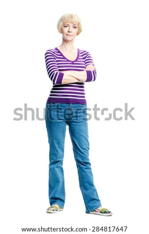Full length portrait of attractive middle aged woman with arms crossed. Isolated on white. - stock photo