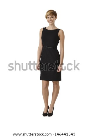Full length portrait of attractive woman wearing black cocktail dress, isolated on white - stock photo
