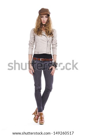 Full length portrait of beautiful blond girl with curly hair in cap - stock photo