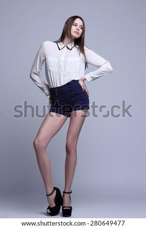 full-length portrait of beautiful brunette woman. Fashion shot - stock photo
