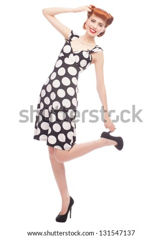 Full length portrait of  beautiful pinup woman with vintage makeup and hairstyle. Isolated on white background - stock photo