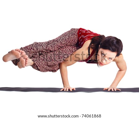 full-length portrait of beautiful woman working out yoga excercise balancing on hands in ashtavakrasana pose - stock photo