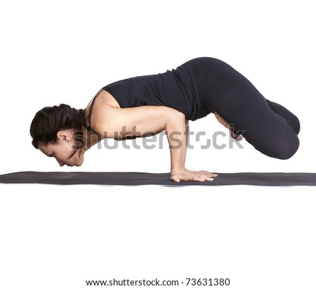 full-length portrait of beautiful woman working out yoga excercise balancing on hands in padma mayurasana pose - stock photo