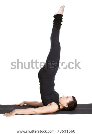 full-length portrait of beautiful woman working out yoga excercise sarvangasana (shoulder stand) on fitness mat - stock photo