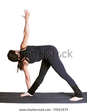 full-length portrait of beautiful woman working out yoga excercise utthita trikonasana on fitness mat - stock photo