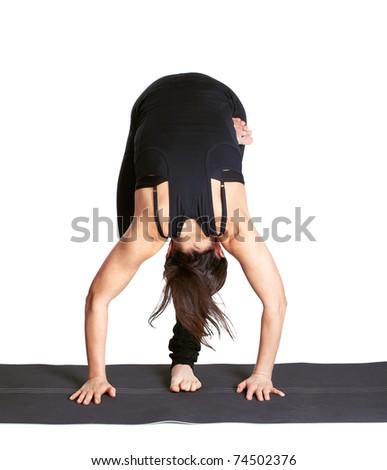 full-length portrait of beautiful woman working out yoga excercises ARDHO baddha padmottanasana on fitness mat - stock photo
