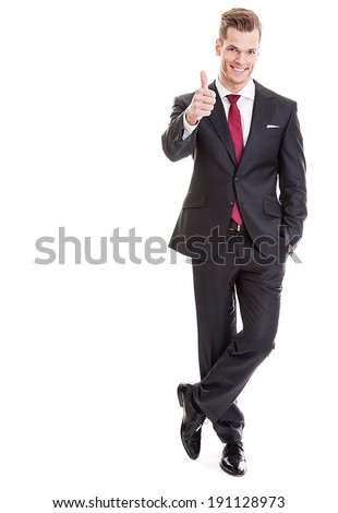 Full-length portrait of business man who thumbs up, isolated on white - Concept of leadership and success - stock photo