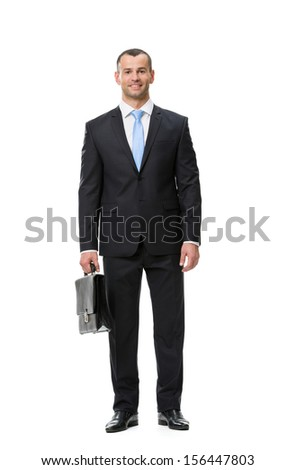 Full-length portrait of businessman with case, isolated on white. Concept of leadership and success - stock photo