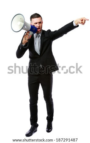 Full length portrait of businessman yelling through megaphone isolated on white background - stock photo