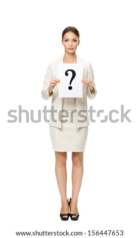 Full-length portrait of businesswoman handing question mark, isolated on white background. Concept of problem and solution - stock photo